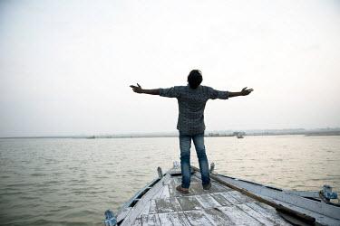 Michael Trevillion FISHERMAN ON BOAT IN INDIA Men