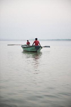 Michael Trevillion FISHERMEN IN BOAT AT SUNSET Men