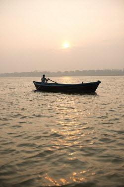 Michael Trevillion FISHERMAN IN BOAT AT SUNSET Men