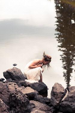 Jen Kiaba WOMAN ON ROCKS BY LAKE Women