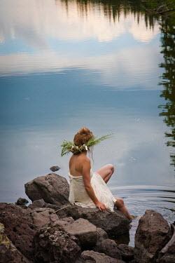 Jen Kiaba WOMAN WITH LEAF HEADDRESS SITTING BY WATER Women