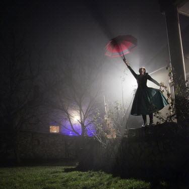 Hanna Nemeth WOMAN WITH UMBRELLA AT NIGHT OUTDOORS Women