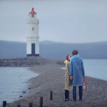 Oleg Oprisco COUPLE WITH LANTERN BY LIGHTHOUSE Couples