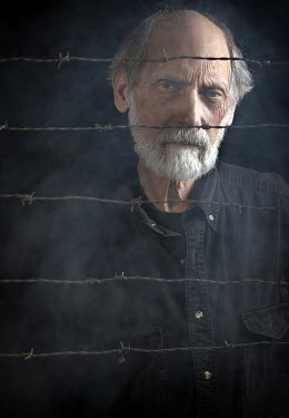 Stephen Carroll MAN STANDING BY BARBED WIRE Old People