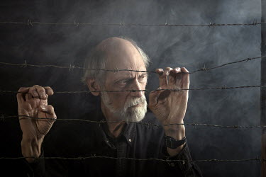 Stephen Carroll MAN HOLDING BARBED WIRE Old People