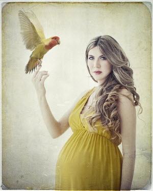 Vanesa Munoz PREGNANT WOMAN WITH PARROT Women