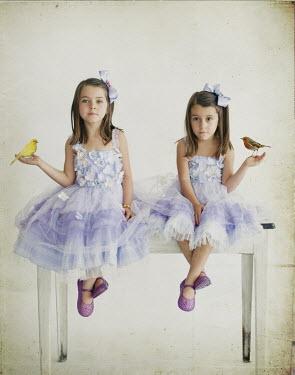 Vanesa Munoz TWO LITTLE GIRLS WITH BIRDS Groups/Crowds