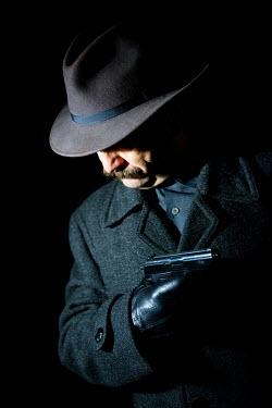 Jaroslaw Blaminsky GANGSTER IN HAT WITH GUN Old People