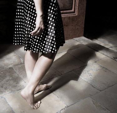 Hanna Nemeth WOMAN WALKING ON STONE FLOOR Women