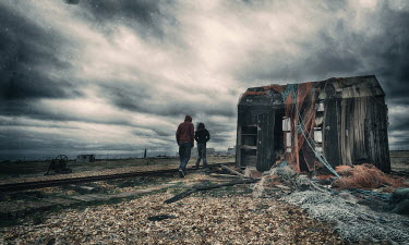 Nicola Smith COUPLE WALKING BY DERELICT FISHING HUT Couples