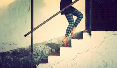 Sandra Villarreal Cabrera WOMAN TIPTOEING UP STEPS Women