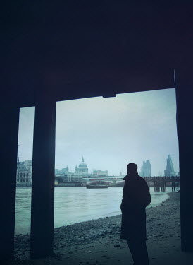 Mark Owen SILHOUETTE OF MAN BY THE RIVER THAMES Men
