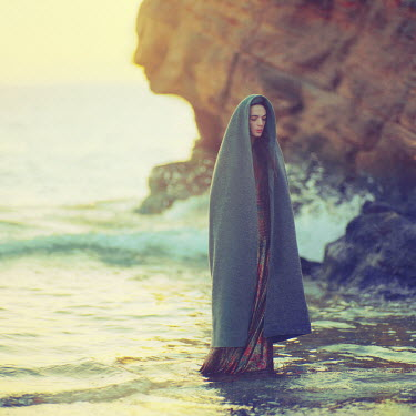 Oleg Oprisco WOMAN STANDING IN WATER WITH SHAWL Women