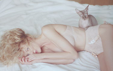 Oleg Oprisco WOMAN ON BED WITH CAT Women
