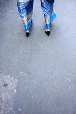 David Gibson TWO WOMEN WITH LONG SKIRTS WALKING Women