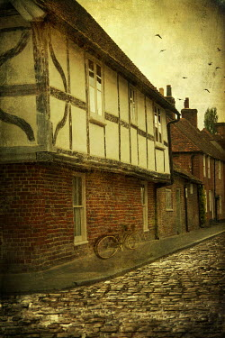 Victoria Davies BICYCLE OUTSIDE TUDOR HOUSE ON COBBLED STREET Houses