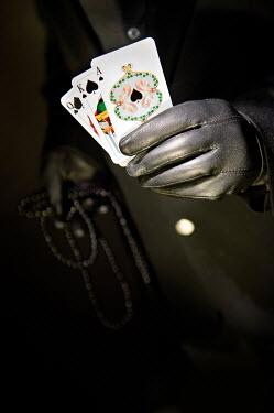 Jaroslaw Blaminsky MALE HAND WITH PLAYING CARDS Men