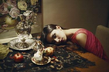 Kamil Akca WOMAN SLEEPING AT DINING TABLE Women