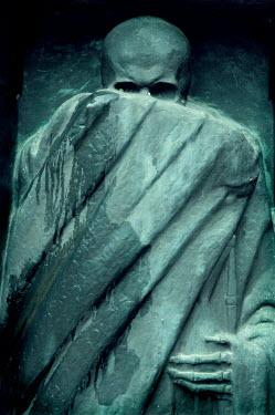 Viona Ielegems GRAVESTONE OF SKELETON COVERING FACE Statuary/Gravestones