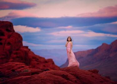 Lisa Holloway GIRL STANDING ON DESERT ROCK Children
