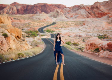 Lisa Holloway WOMAN STANDING ON DESERT ROAD Women