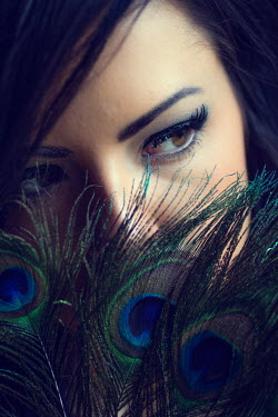 Elisabeth Ansley CLOSE UP OF WOMAN WITH PEACOCK FEATHERS Women
