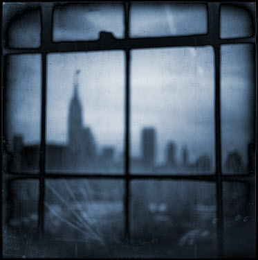 Gary Isaacs SILHOUETTE OF CITY SKYLINE THROUGH WINDOW Miscellaneous Buildings