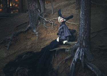 Margarita Kareva GLAMOROUS BLOND WOMAN SITTING IN FOREST Women