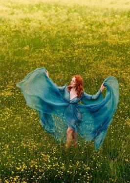 Rayment Kirby WOMAN IN DRESS IN MEADOW OF FLOWERS Women