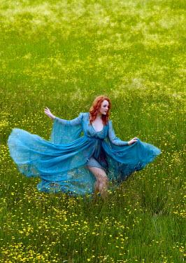 Rayment Kirby WOMAN DANCING IN MEADOW OF FLOWERS Women
