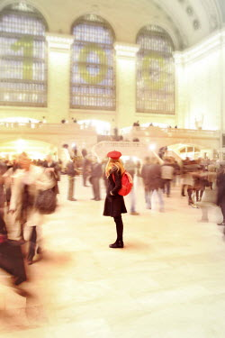 ILINA SIMEONOVA WOMAN STANDING IN BUSY STATION Groups/Crowds