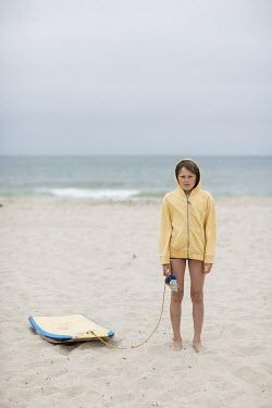 Doreen Kilfeather BOY ON BEACH WITH BODY BOARD Men