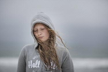 Doreen Kilfeather TEENAGE GIRL ON BEACH WITH HOOD Women