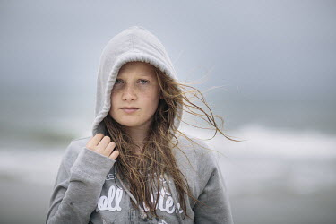 Doreen Kilfeather TEENAGE GIRL ON BEACH IN HOODED SWEATSHIRT Women