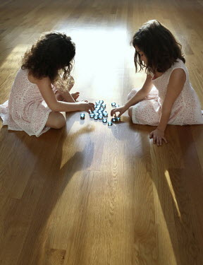 Stephen Carroll TWO LITTLE GIRLS PLAYING MARBLES Groups/Crowds