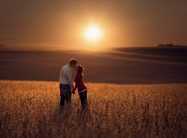 Jake Olson COUPLE KISSING IN FIELD AT SUNSET Couples
