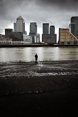 Andy & Michelle Kerry MAN LOOKING OUT TO CANARY WHARF, LONDON Specific Cities/Towns