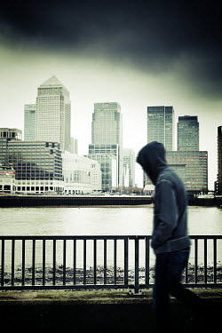Andy & Michelle Kerry HOODED MAN WALKING PAST CANARY WHARF, LONDON Men