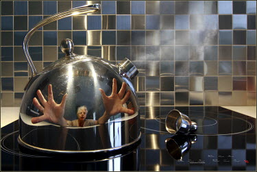 Franck Losay MAN REFLECTED IN BOILING KETTLE Miscellaneous Objects