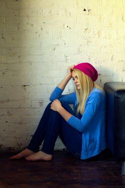 Elisabeth Ansley THOUGHTFUL TEENAGE GIRL SITTING DOWN Women