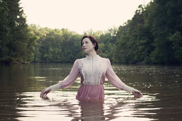 Heather Evans Smith WOMAN IN VINTAGE DRESS, STANDING IN LAKE Women