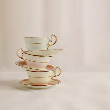 Michelle Anderson STACK OF CHINA CUPS AND SAUCERS Miscellaneous Objects