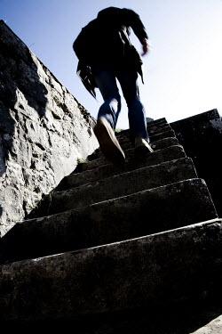 Karl Gough MAN RUNNING UP STEPS Men
