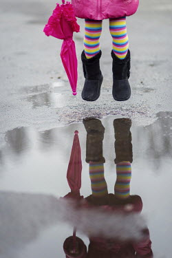 Karina Simonsen LITTLE GIRL JUMPING BY PUDDLE Children