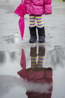 Karina Simonsen LITTLE GIRL BY PUDDLE WITH UMBRELLA Women
