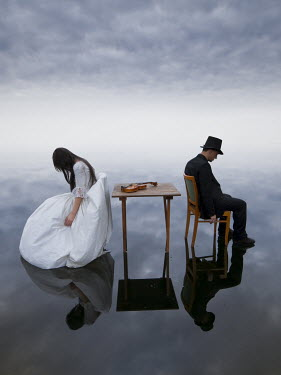 Leszek Paradowski SURREAL IMAGE OF COUPLE ON CHAIRS FLOATING ON WATER Groups/Crowds