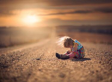 Jake Olson LITTLE GIRL ON ROAD AT SUNSET Children