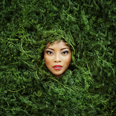 Vanessa Paxton YOUNG WOMAN PEERING OUT OF BUSH Women