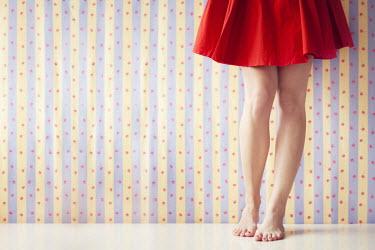Vanessa Paxton FEMALE LEGS BY PATTERNED WALLPAPER Women