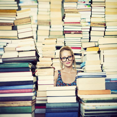 Vanessa Paxton GIRL WEARING GLASSES WITH BOOKS Women
